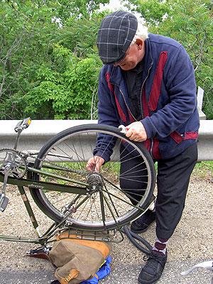 Ian working on his flat tyre