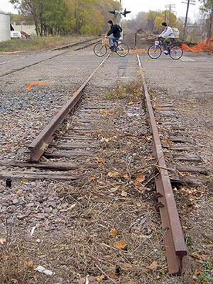 Cyclists cross railway tracks