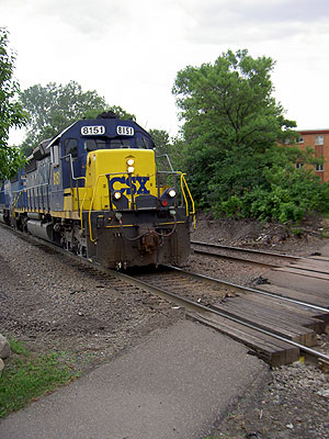CSX train at Black Bear Crossings sidewalk