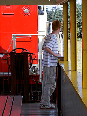 Henry on open car of train
