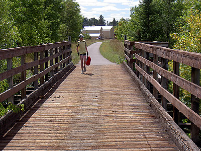 Henry retrieves pannier on Willow River bridge