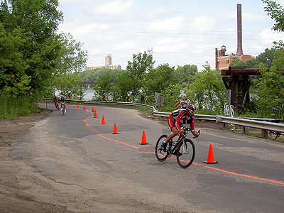 Three riders coming through the road bend