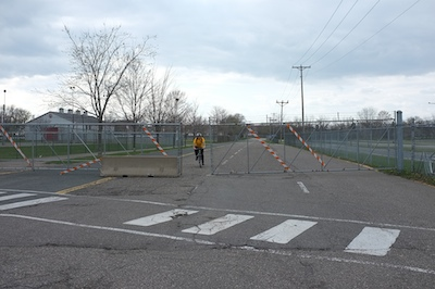 Cyclist comes through the Hoyt State Fairgrounds gate, March 2012.