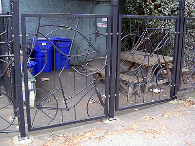 Gate made of bike frames at River City Bicycles in Portland, Oregon