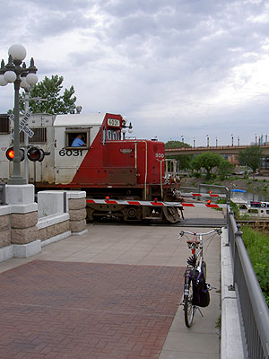 Train crosses pedestrian path in Saint Paul