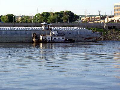 The Angela Kay nudges a barge
