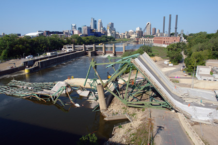 Large Depth of Field with a short lens.  Collapsed I-35W bridge over Mississippi River, Minneapolis, Minnesota, September 2007.  Sony DSC-R1, 14.3mm lens, 1/400th at f/8, ISO 160.  Photo by Matthew Cole.