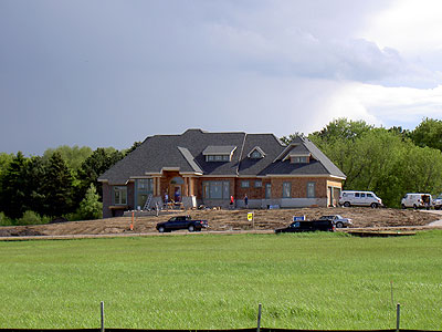 McMansion going up just south of Gem Lake Golf Course