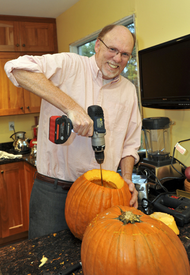 A drill with a Pumpkin Gutter and a jigsaw make quick work of getting pumpkins ready